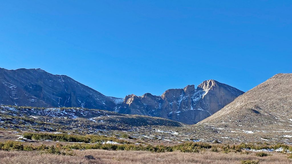 Longs Peak peeking out from the trail junction - the view always gets me excited